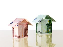 Euro banknotes are combined in small houses (file contains clipping path for objects)